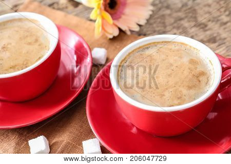 Cups of aromatic morning coffee on table