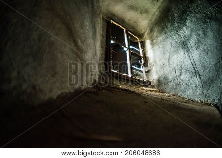 Mystical interior. Old window in dark castle dungeon. Ray of light