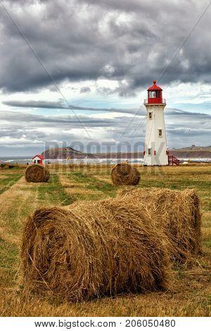 Lighthouse in Havre Aubert in Magdalen island in Quebec, Canada poster