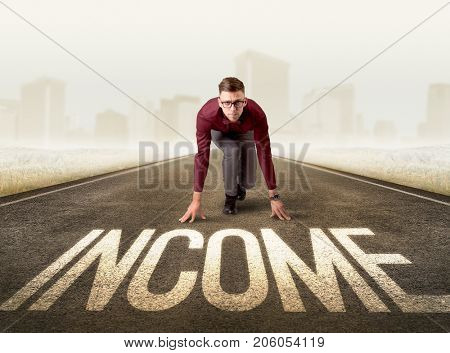 Young determined businessman kneeling before income sign