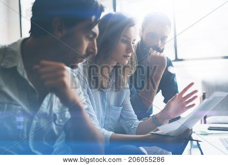 Three partners making research for new business direction.Business people meeting concept.Blurred background.Cropped