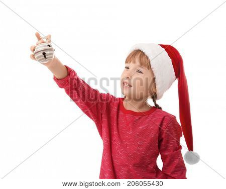 Cute little girl with jingle bell on white background