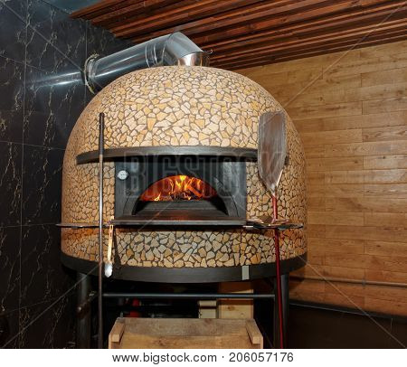 Traditional wood-fired pizza oven in Italian restaurant