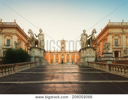 Campidoglio square with entrance stairs at sunrise, Capitoline hill in Rome, Italy, retro toned