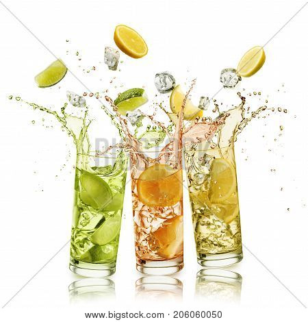 citrus fruits soft drink with fruit slices and ice cubes falling and splashing on white background