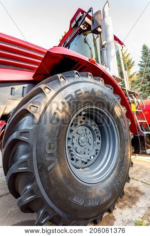 Russia Samara - September 23 2017: Big wheel of new modern agricultural tractor Kirovets K 4 exhibited at the annual Volga agro-industrial exhibition