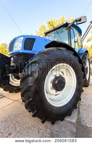 Russia Samara - September 23 2017: Modern agricultural tractor New Holland exhibited at the annual Volga agro-industrial exhibition