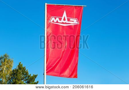 Samara Russia - September 23 2017: Dealership flag Minsk Automobile Plant (MAZ) over blue sky. MAZ is a Belarussian automaker one of the largest in Eastern Europe