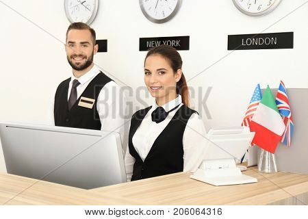 Two hotel receptionists at workplace
