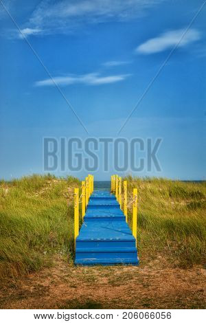 Blue and yellow wooden walkway to nowhere with space for your text