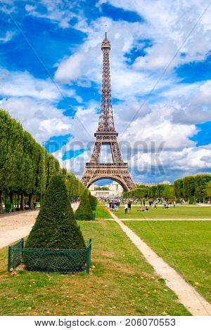 The Eiffel Tower and the Champ de Mars on a beautiful summer day in Paris