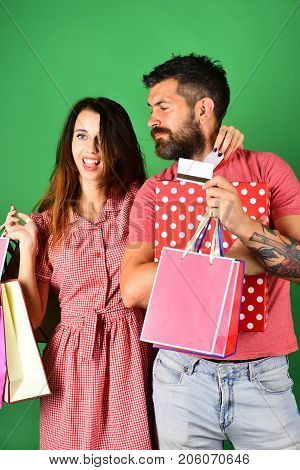 Man With Beard Holds Credit Card And Polka Dotted Box
