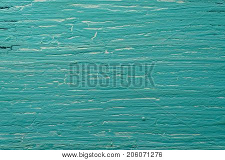 Turquoise wooden board with old oil paint, texture
