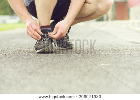 Concept Of Sports And Marathon With Man Tying His Sneakers