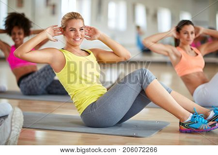 Blond female in fitness group on training in fitness class