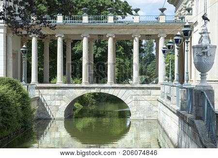 The bridge of historic Palace on the Isle in Warsaw downtown Lazienki Park (Poland).