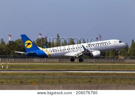 Borispol, Ukraine - September 26, 2017: Ukraine International Airlines Embraer ERJ190-100 aircraft landing on the runway of Borispol International Airport on September 26, 2017. Editorial use only