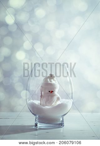 Snowman in snowglobe with sparkle background
