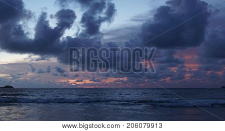 Beautiful summery colorful sunset sky over the sea