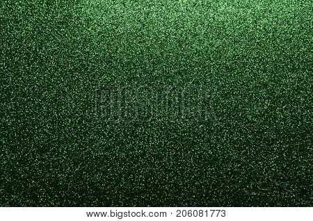 Green glittering background suitable for a festive scene