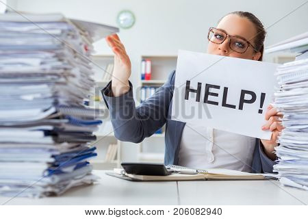 Businesswoman pleading for help in office