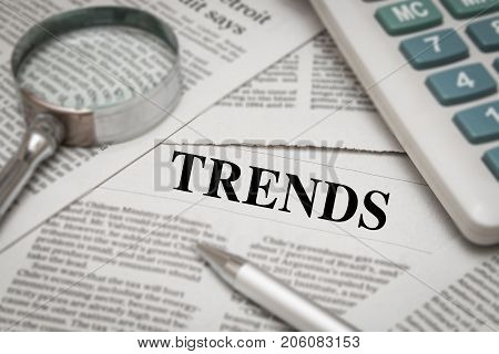 trends analysis with trends headline on newspaper background