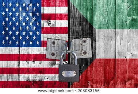 US and Kuwait flag on door with padlock