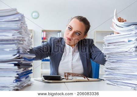 Tired businesswoman with paperwork workload