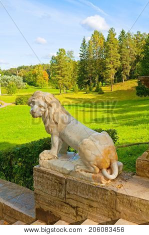 PAVLOVSK ST PETERSBURG RUSSIA - SEPTEMBER 21 2017. Large stone staircase and sculpture of a lion in Pavlovsk park near St Petersburg Russia