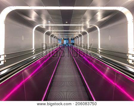 Norway, Oslo - JUNE 08, 2017: Neon escalator tunnel in Train Station
