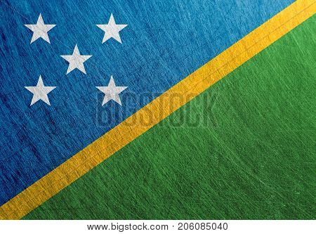 Solomon Islands flag metal vintage retro scratched steel background.