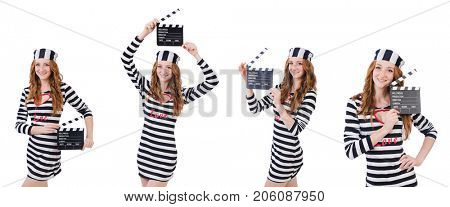 Young woman-prisoner with movie board isolated on white
