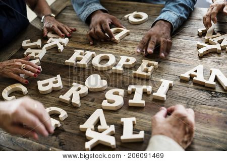 A wooden alphabet hope word on the table