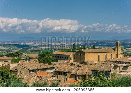 View On Tuscany Landscape Over The Roofs Of Small Town