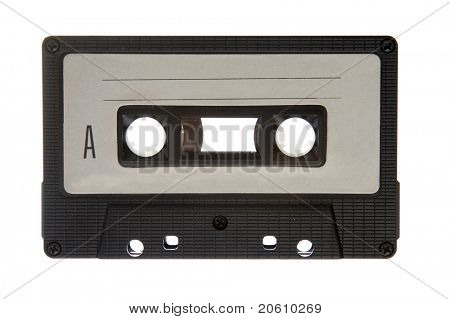 Old tape cassette isolated on white background, dusty and grunge
