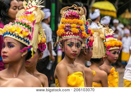 Bali, Indonesia - September 17, 2016: Unidentified balinese young artists preparing for Galungan celebration in Ubud, Bali.