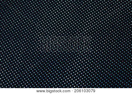 Black perforated leather texture background blue dots