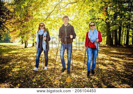 Nordic walking - active people working out in city park