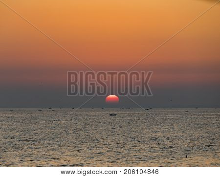 Sunset and fishing boats in Marmara Sea Turkey during sunset