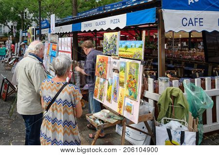 PARIS,FRANCE - JULY 31,2017 : Painters at the Place du Tertre in the historic district of Montmartre