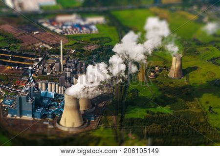 Tilt shift blur effect. Aerial view of power station. Power plant. Fossil fuel power plant in operation, aerial view. Cooling towers, aerial view.