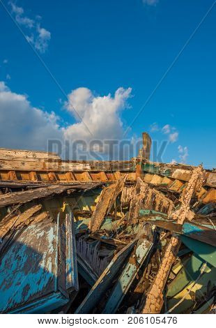 wreck boat on the road at Eleusis Greece