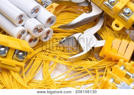 Tools and cables used in electrical home installation, closeup