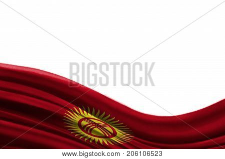 Grunge colorful flag Kyrgyzstan with copyspace for your text or images,isolated on white background. Close up, fluttering downwind.