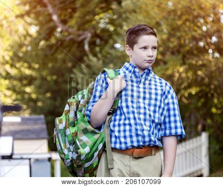 Young boy with backpack headed for school