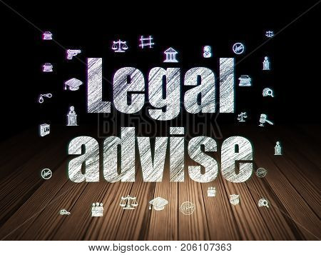 Law concept: Glowing text Legal Advise,  Hand Drawn Law Icons in grunge dark room with Wooden Floor, black background
