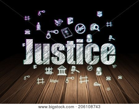Law concept: Glowing text Justice,  Hand Drawn Law Icons in grunge dark room with Wooden Floor, black background