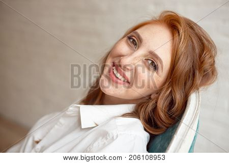 Close Up Portrait Of Young Smiling Red-haired Woman On Black Background