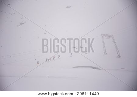 Travelers People Group Walk And Trekking On Snow At Top Of Mountain