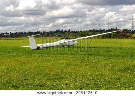 Sailplane, glider airplane wide angle shot on the ground field waiting for take-off.